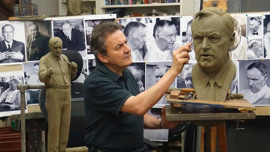 "In this July 2016 photo, sculptor Zenos Frudakis works on a statue of attorney Clarence Darrow in his studio in Glenside, Penn. The statue is to be placed near a statue of William Jennings Bryan outside the Rhea County Courthouse in Dayton, Tenn., where the two men faced off in the 1925 Scopes ""monkey trial."" (Rosalie Frudakis via AP)"