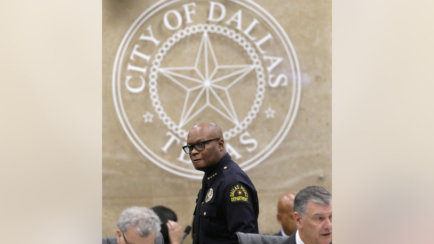 Dallas Police Chief David Brown arrives to speak during a city council budget meeting at Dallas City Hall, Tuesday, Aug. 9, 2016, in Dallas. Brown says several officers testifying on the fatal shooting of five colleagues last month were overwhelmed when they returned to the scene and that some could need up to five years of treatment to recover from the trauma. Brown told the city council that more than 300 witnesses have been interviewed in the investigation into the shooting July 7 during a protest march in downtown Dallas. (AP Photo/LM Otero)