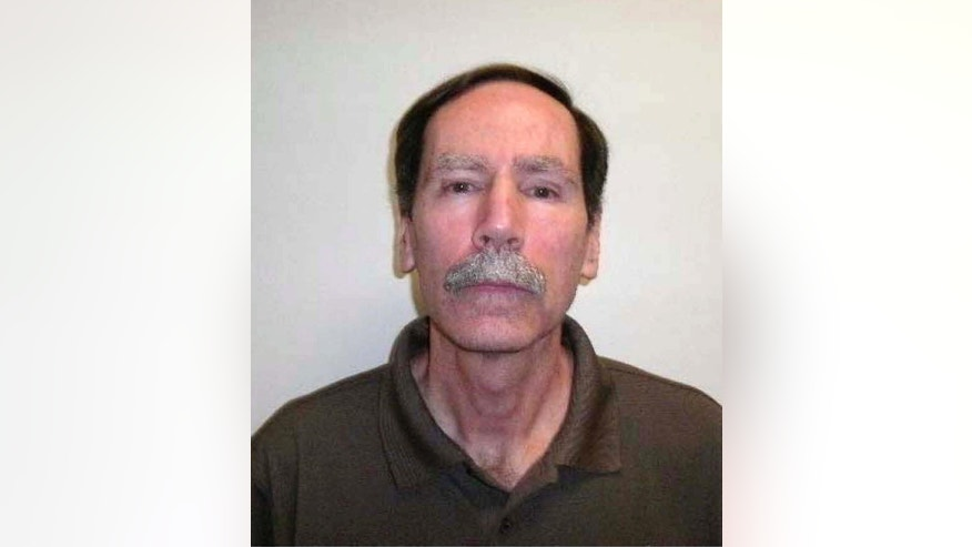 This undated law enforcement booking photo, released by the Los Angeles County Sheriff's Department in 2014, shows Christopher Hubbart. Hubbart, now 65, a notorious rapist who muffled his victim's screams with a pillowcase, was back in custody Tuesday, Aug. 9, 2016, two years after he was released from a psychiatric hospital over the protests of prosecutors and women who feared he would attack again. Jane Robison, a spokeswoman for the Los Angeles County district attorney, did not specify why Hubbart was returned to custody. (Los Angeles County Sheriff's Department via AP)