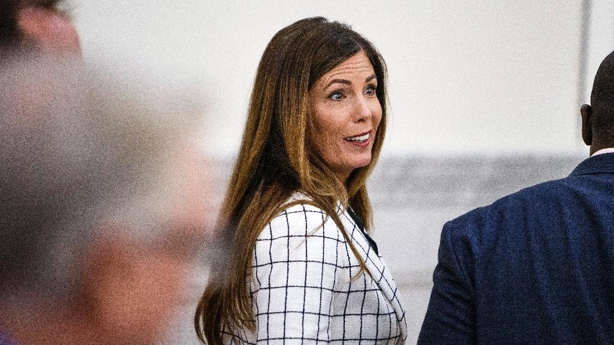 Pennsylvania Attorney General Kathleen Kane leaves the courtroom for a short recess on the second day of her trial at the Montgomery County Courthouse in Norristown, Pa., Tuesday, August 9, 2016. Kane faces perjury and other charges related to the alleged leak of secret grand jury materials. (Dan Gleiter/PennLive.com via AP, Pool)