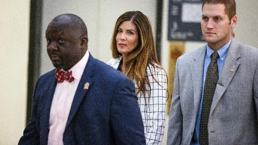 Pennsylvania Attorney General Kathleen Kane, center, walks to the courtroom during a short recess on the second day of her trial at the Montgomery County Courthouse in Norristown, Pa., Tuesday, Aug. 9, 2016. Kane faces perjury and other charges related to the alleged leak of secret grand jury materials. (Dan Gleiter/PennLive.com via AP, Pool)