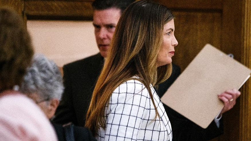 Pennsylvania Attorney General Kathleen Kane leaves the courtroom for a short recess on the second day of her trial at the Montgomery County Courthouse in Norristown, Pa., Tuesday, Aug. 9, 2016. Kane faces perjury and other charges related to the alleged leak of secret grand jury materials. (Dan Gleiter/PennLive.com via AP, Pool)
