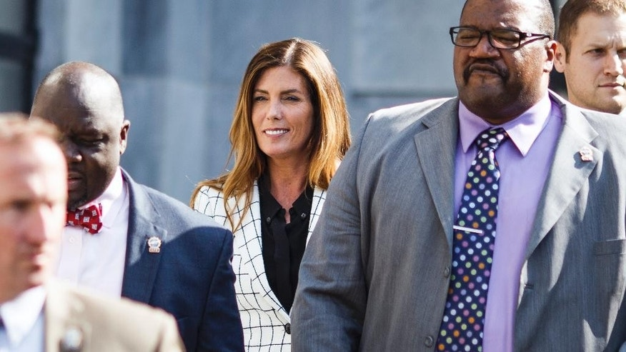 Pennsylvania Attorney General Kathleen Kane leaves court after the second day of her trial at the Montgomery County Courthouse in Norristown, Pa. Tuesday, Aug. 9, 2016. Kane faces perjury and other charges related to the alleged leak of secret grand jury materials. (Dan Gleiter/PennLive.com via AP, Pool)