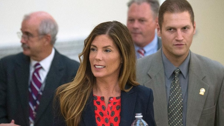 "Pennsylvania attorney general Kathleen Kane leaves Montgomery County's courtroom during a lunch break in her trial, Wednesday, Aug. 10, 2016. in Norristown, Pa. A former top aide to Pennsylvania's attorney general Kathleen Kane testified Wednesday that his ""heart sank a little"" when his boss asked him to try to block a special investigation into a grand jury leak. (Clem Murray/The Philadelphia Inquirer via AP, Pool)"