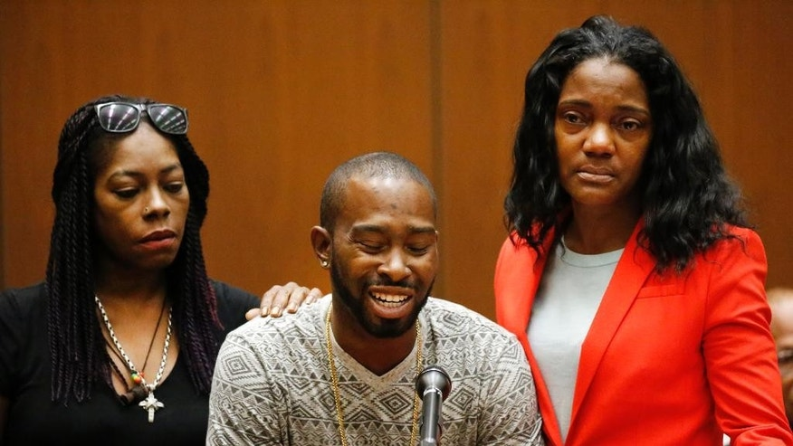 "Relatives of victim Mary Lowe from left, Kenneitha Lowe, Cameron Wright and Tracy Williams, speak during victims statements before the sentencing for Lonnie Franklin Jr., a convicted serial killer known as the ""Grim Sleeper,"" in Los Angeles Superior Court, Wednesday, Aug. 10, 2016. Franklin was sentenced to death for 10 Los Angeles murders that spanned decades. (Al Seib/Los Angeles Times via AP, Pool)"