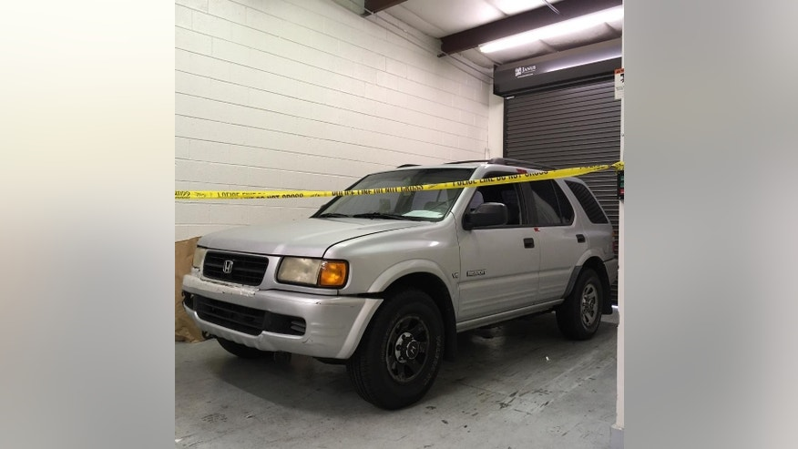 This photo provided by Roswell Police Department shows a sports utility vehicle that belongs to Jeffrey A. Hazelwood, arrested Wednesday, Aug. 3, 2016, charged with two counts of murder in the killings of Carter Davis and Natalie Henderson. Police investigating the killings of the two teenagers in Atlanta's suburbs say they want to hear from anyone who saw the sport utility vehicle and became suspicious. (Roswell Police Department via AP)