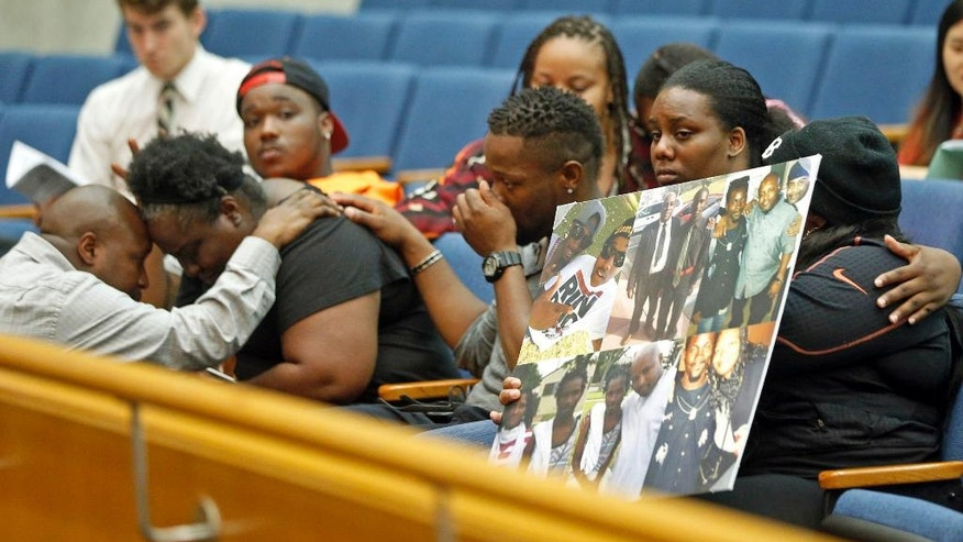 Matrice Stanley, at left in black, sister of Donnell Thompson, 27, who was fatally shot by Los Angeles County Sheriff's deputies in Compton, Calif., and other family members appear before Los Angeles County supervisors at the County Hall of Administration in downtown Los Angeles Tuesday, Aug. 9, 2016. The Sheriff's Department earlier Tuesday had acknowledged that Thompson was not involved with a carjacker who had fired at pursuers when he was shot and killed on July 28, 2016. (AP Photo/Nick Ut)
