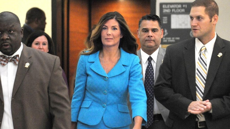 Pennsylvania Attorney General Kathleen Kane enters the Montgomery County courtroom on Thursday, August 11, 2016 to continue her trial in Norristown, Pa. Kane, a first-term Democrat, is accused of leaking secret grand jury documents to the press and lying about it under oath. (Art Gentile/Bucks County Courier Times via AP, Pool)