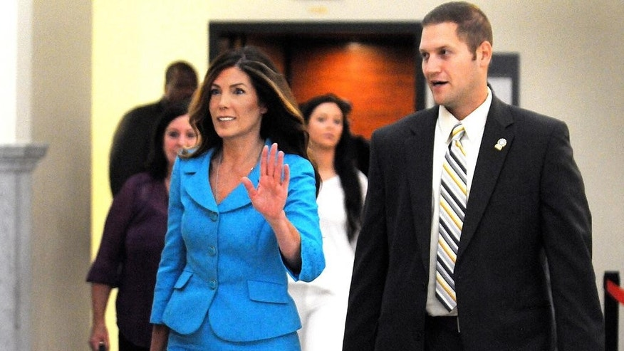Pennsylvania Attorney General Kathleen Kane waves as she enters the Montgomery County courtroom on Thursday, August 11, 2016 to continue her trial in Norristown, Pa. Kane, a first-term Democrat, is accused of leaking secret grand jury documents to the press and lying about it under oath. (Art Gentile/Bucks County Courier Times via AP, Pool)