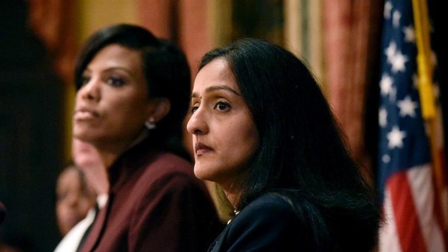 Baltimore Mayor Stephanie Rawlings-Blake, left, and Principal Deputy Assistant Attorney General Vanita Gupta listen to a question during a news conference at City Hall in response to a Justice Department report, Wednesday, Aug. 10, 2016 in Baltimore. The Justice Department and Baltimore police agreed to negotiate court-enforceable reforms after a scathing federal report released Wednesday criticized officers for using excessive force and routinely discriminating against blacks. (Kim Hairston/The Baltimore Sun via AP)