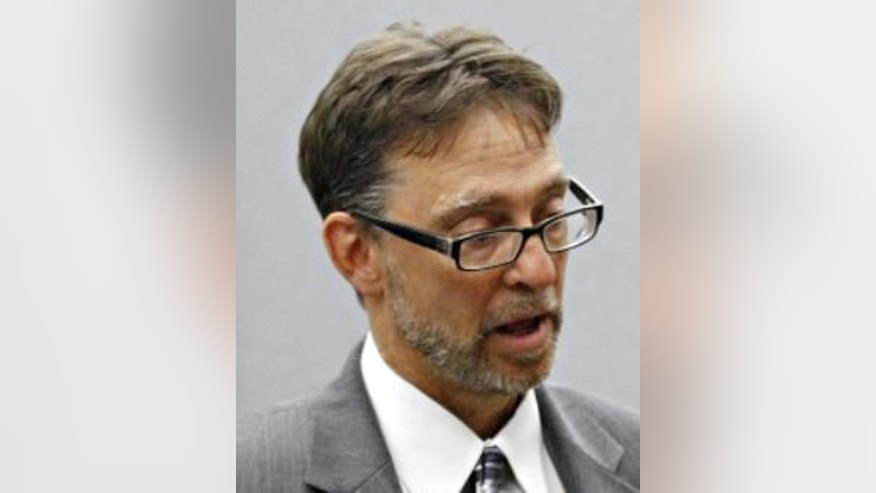 This undated photo shows civil rights attorney Tom Frerichs in Waterloo, Iowa. Waterloo, the city with Iowa's highest African-American population has settled lawsuits against white officers who roughed up three black residents during incidents which took place between 2013 and 2015. Frerichs represented all three plaintiffs. (Nancy Newhoff/The Courier via AP)
