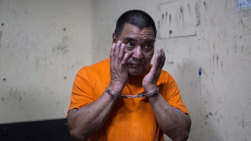 Santos Lopez Alonzo stands in a courtroom as he waits for his first hearing in Guatemala City, Wednesday, Aug. 10, 2016. Lopez Alonzo, former Guatemalan soldier suspected of helping carry out a massacre of more than 160 people in 1982 during the country's civil war was deported from the United States on Wednesday after a court refused his plea to stay because he fears for his life. (AP Photo/Luis Soto)