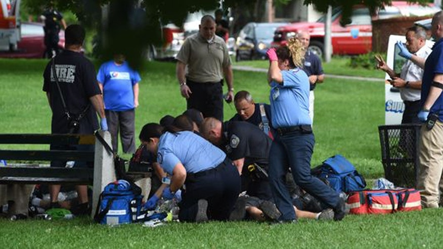 Aug. 12, 2016: Paramedics treat one of five people who were injured Friday after lightning struck at a park in Poughkeepsie, N.Y.