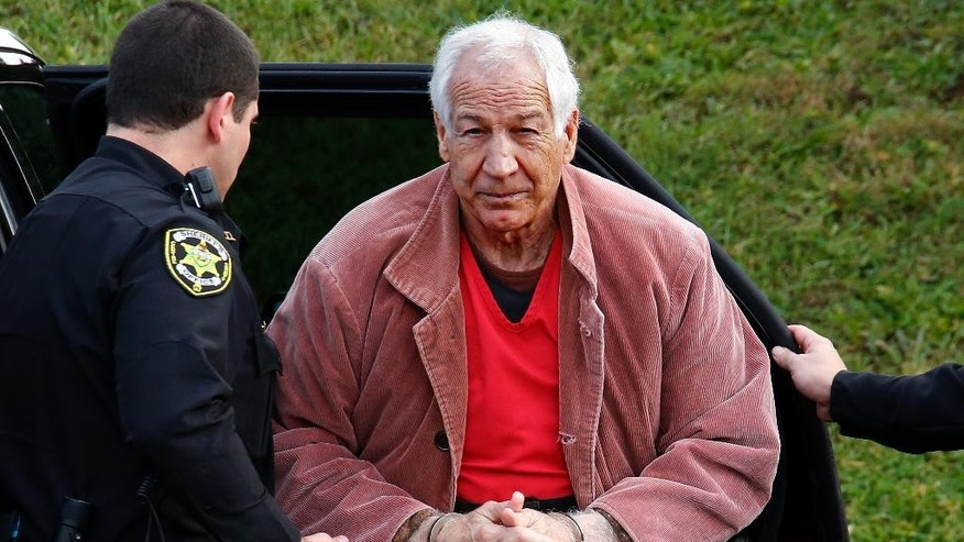 FILE - In this Oct. 29, 2015, file photo, former Penn State University assistant football coach Jerry Sandusky arrives for an appeal hearing at the Centre County Courthouse in Bellefonte, Pa. During a three-day Post-Conviction Relief Act hearing beginning Friday, Aug. 12, 2016, Sandusky is seeking to overturn his 45-count conviction of sexually abusing 10 boys, from a 2012 trial where he didn't take the stand. (AP Photo/Gene J. Puskar, File)