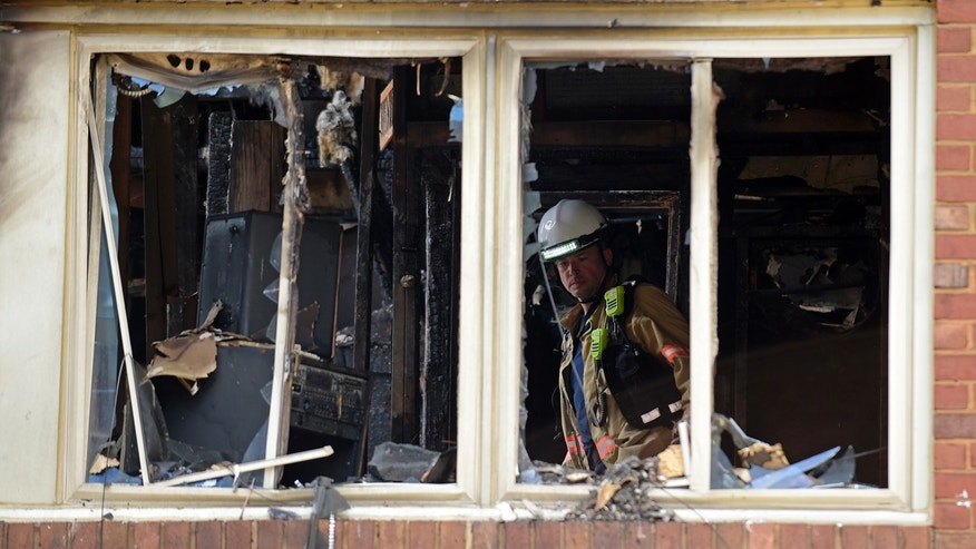 Aug. 11, 2016: Emergency personnel investigate the inside of an apartment building following a fire in Silver Spring, Md.