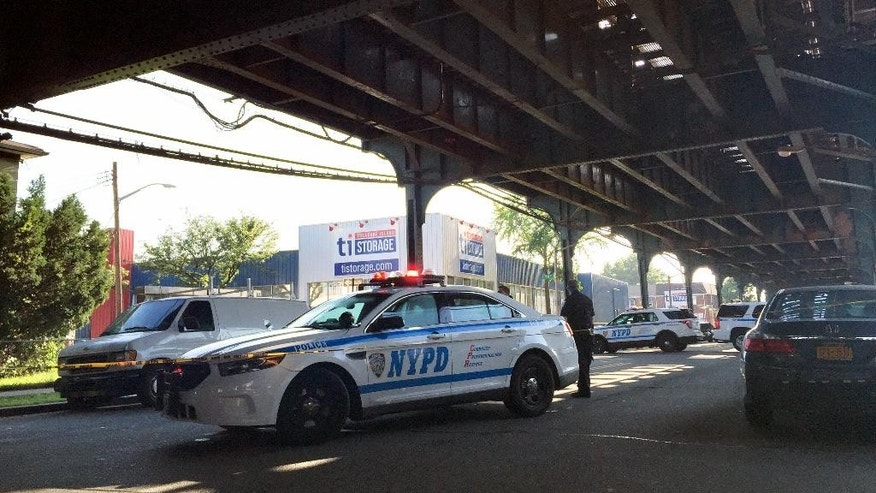 New York City police secure the scene where two men were shot as they left prayers at a mosque in the Queens borough of New York, Saturday, Aug. 13, 2016. Police identified the victims as Imam Maulama Akonjee, the 55-year-old leader of the mosque, who died at the hospital, and a 64-year-old man. (AP Photo/Jennifer Peltz)