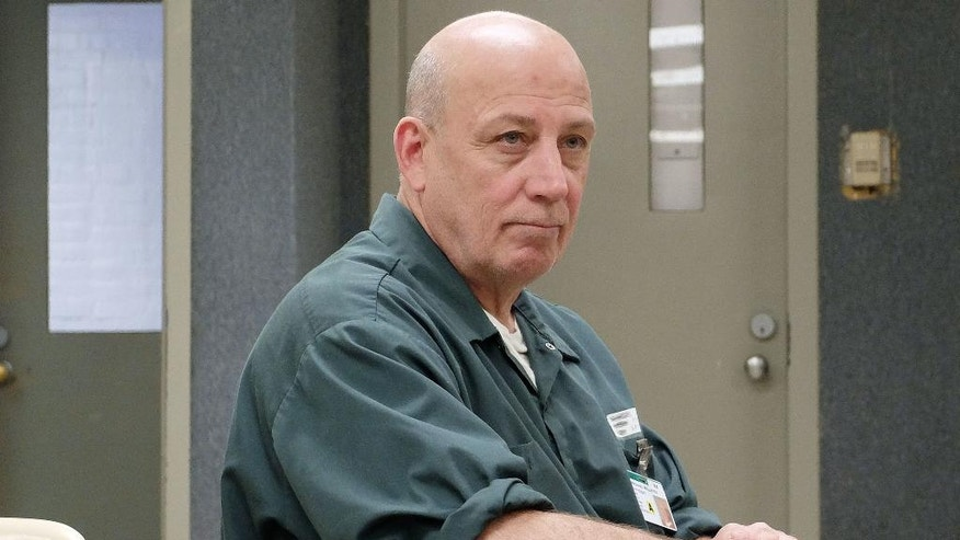 Mike Millette sits in the visitors center at the state prison in Concord, N.H., on Tuesday, May 31, 2016. Millette's friend, Ed Martin III, had been found dead in the bathroom of a convenience store, slumped over on his knees with a needle and a residue-stained spoon in his pocket. He'd mainlined fentanyl, an opioid up to 50 times more powerful than heroin. Martin's overdose would bring tears to his eyes. But he was scared, too. He was his dealer, the man who'd sold him his final fix. (AP Photo/Jim Cole)