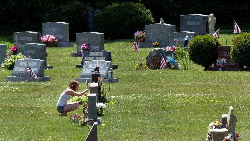 Erika Marble visits the gravesite of Edward Martin III, her fiance and father of her two children, in Littleton, N.H., on Friday, June 17, 2017. The 28-year old died Nov. 30, 2014 from an overdose of the opioid Fentanyl. (AP Photo/Jim Cole)
