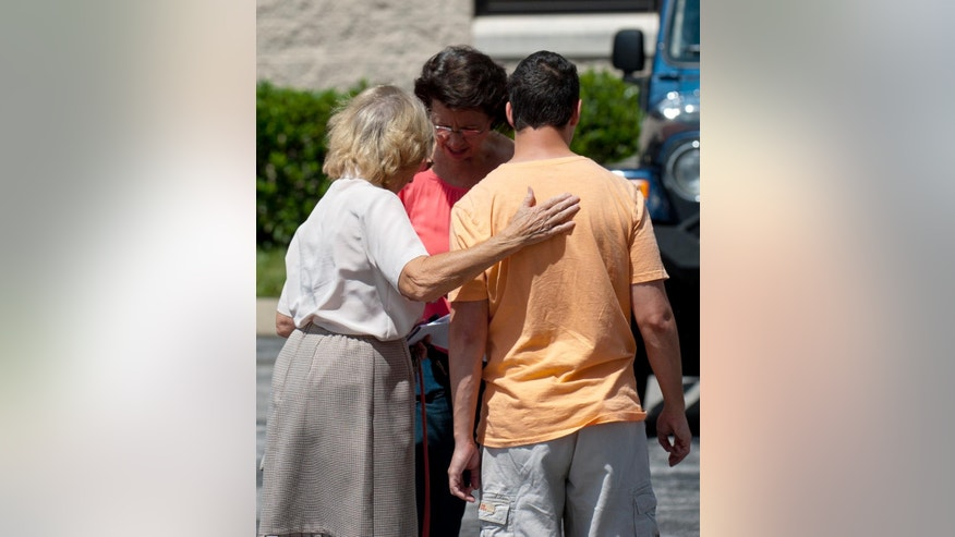 Church members gather outside Hillvue Heights Baptist Church, in Bowling Green, Ky., Sunday, Aug. 14, 2016, after a man allegedly stabbed his father during services.  (AP Photo/Daily News, Miranda Pederson)