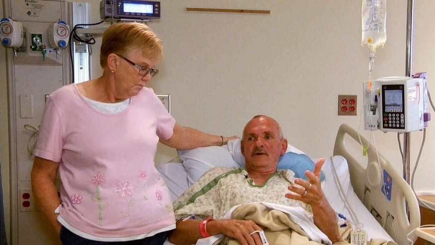 This Sunday, Aug. 14, 2016, photo provided by KOAM-TV in Joplin, Mo., shows Don and Debbie Pugh speaking from a hospital room in Joplin. The Pughs were among victims in apparently random shootings Saturday, Aug. 13 in Joplin. The couple were driving to work when a man shot at their truck Saturday, aug. 13, 2016, hitting Don three times. Six people and two dogs were injured before the suspect, Tom Mourning II, was captured. (KOAM-TV via AP)