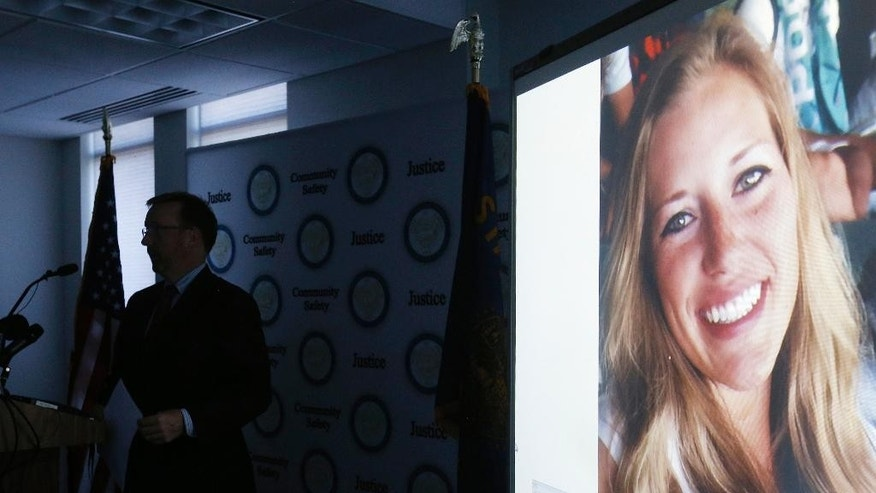 FILE--In this July 26, 2016, file photo, a picture of Kaylee Sawyer is displayed on a screen as Deschutes County District Attorney John Hummel speaks during a press conference on at the Deschutes County Courthouse in Bend, Ore. The murder of Kaylee Sawyer followed by a string of other crimes leading from Oregon through California allegedly committed by Central Oregon Community College safety officer Edwin Lara has this scenic mountain town deeply shaken. (Joe Kline/The Bulletin via AP, file)