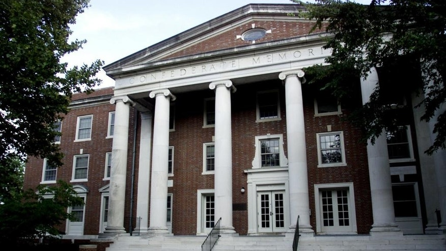 FILE - This Sept. 30, 2003, file photo, shows the exterior of a dormitory at Vanderbilt University in Nashville, Tenn., is inscribed with the name Confederate Memorial Hall. The private university announced on Monday, Aug. 15, 2016, that it has struck an agreement to pay $1.2 million to United Daughters of the Confederacy to remove the name from the building. (AP Photo/The Tennessean, Ricky Rogers, File)