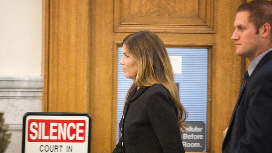 Pennsylvania Attorney General Kathleen Kane, escorted by a member of her security team, prepares to leave the Montgomery County Courthouse and await a verdict, in Norristown, Pa., Monday, Aug. 15, 2016. Kane was convicted Monday of all nine charges against her in a perjury and obstruction case related to a grand jury leak but insisted she's innocent and vowed to appeal. Kane, the first Democrat and first woman elected to the office, showed little emotion as jurors announced their verdict Monday.  (Ed Hille/The Philadelphia Inquirer via AP, Pool)