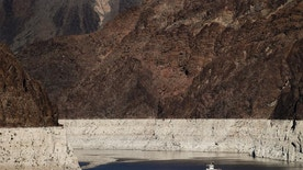 FILE--In this Oct. 14, 2015, file photo, a riverboat glides through Lake Mead on the Colorado River at Hoover Dam near Boulder City, Nev. Amid an historic drought in the West, federal water managers are due to release an annual projection of surface levels at Lake Mead that'll determine whether water deliveries from the crucial Colorado River reservoir will be cut next year to Arizona, Nevada and California. (AP Photo/Jae C. Hong, file)