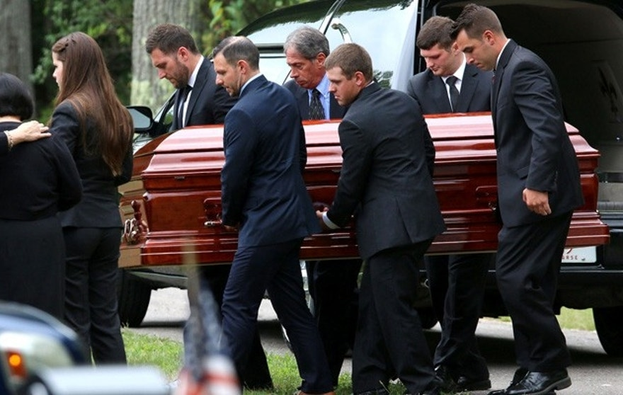 Pall Bearers carry the casket of Vanessa Marcotte at Woodside Cemetery Tuesday, Aug. 16, 2016, in Westminster, Mass. Marcotte, 27, who worked for Google in New York City, was killed Aug. 7 while out running near her mother's Massachusetts home. Investigators have received more than 600 tips, but no arrests have been announced. They say her male assailant may have suffered cuts, scratches and bruises from a struggle. (John Love/The Sentinel & Enterprise via AP)