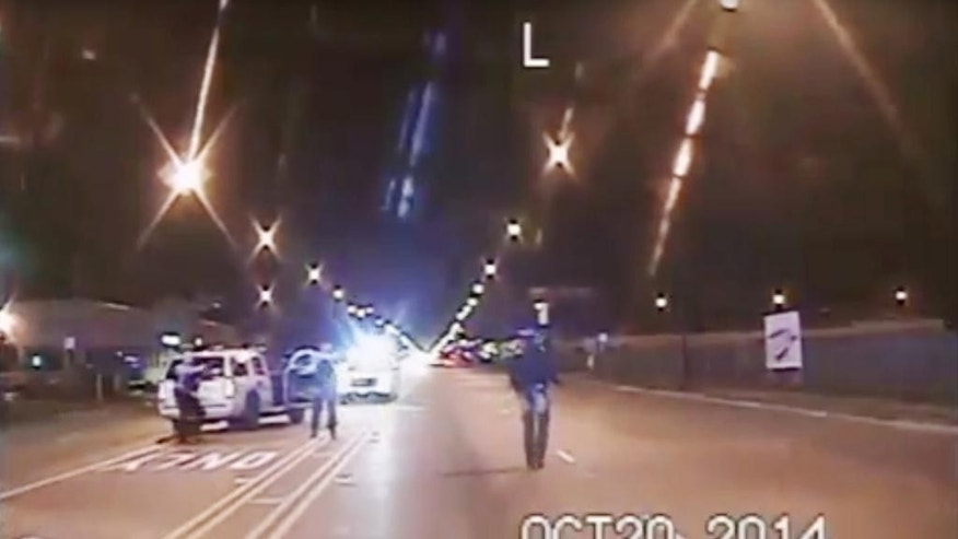 FILE - In this Oct. 20, 2014 frame from dash-cam video provided by the Chicago Police Department, Laquan McDonald, right, walks down the street moments before being fatally shot by officer Jason Van Dyke sixteen times in Chicago. The city's Inspector General's office has delivered a report on the shooting. CPD spokesman Anthony Guglielmi says the department is reviewing the report and will respond. (Chicago Police Department via AP File)