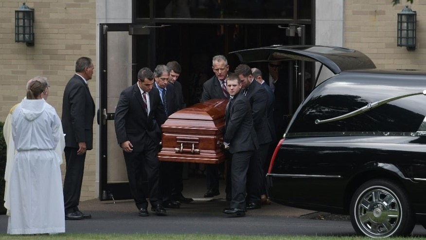 Pall Bearers the casket of Vanessa Marcotte after her funeral service at Our Lady of the Lake Roman Catholic church Tuesday, Aug. 16, 2016, in Leominster, Mass. Marcotte, 27, who worked for Google in New York City, was killed Aug. 7 while out running near her mother's Massachusetts home. Investigators have received more than 600 tips, but no arrests have been announced. They say her male assailant may have suffered cuts, scratches and bruises from a struggle. (Christine Peterson/Worcester Telegram & Gazette via AP)