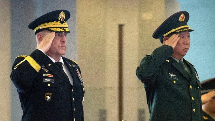 U.S. Army Chief of Staff Gen. Mark Milley, left, and China's People's Liberation Army (PLA) Gen. Li Zuocheng, right, salute during a welcome ceremony at the Bayi Building in Beijing, Tuesday, Aug. 16, 2016. (AP Photo/Mark Schiefelbein, Pool)