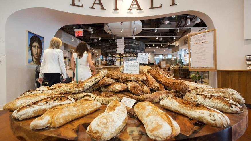 In this Monday, Aug. 15, 2016, photo, freshly baked breads are displayed at the entrance to Eataly, in New York. The Italian restaurant chain and food emporium will open its World Trade Center location, Tuesday, Aug. 16. (AP Photo/Mark Lennihan)