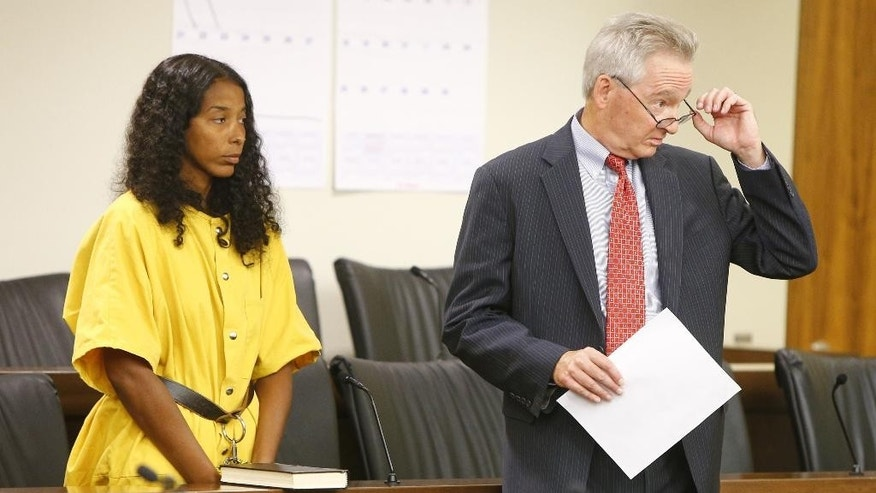 Jennifer Sweeney, left, makes her first appearance in court Wednesday, Aug. 17, 2016, in Freehold, N.J. Authorities say a New Jersey woman who disappeared months after she survived a shooting has been found dead and two people have been charged. Monmouth County prosecutors say 33-year-old Sweeney and 32-year-old Andre Harris were charged Tuesday with murder, desecration of human remains and evidence tampering in the death of 41-year-old Tyrita Julius.  (Thomas P. Costello  /The Asbury Park Press via AP)