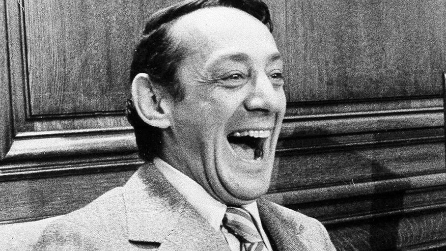 FILE - In this April 1977 file photo, San Francisco supervisor Harvey Milk sits in the mayor's office during the signing of the city's gay rights bill in San Francisco.