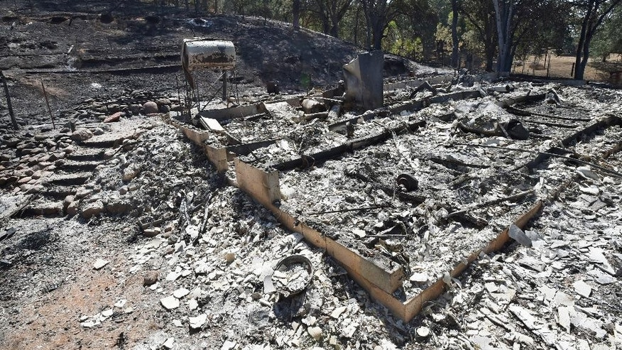 FILE - This Aug. 3, 2015 file photo shows a residence destroyed by the Rocky Fire near Clearlake, Calif. The Rocky Fire that destroyed 43 homes in 2015 in a largely rural area north of San Francisco was sparked by an illegal marijuana growing operation, officials said Wednesday, Aug. 17, 2016. Two suspects fled the country before they could be questioned. (AP Photo/Josh Edelson, File)