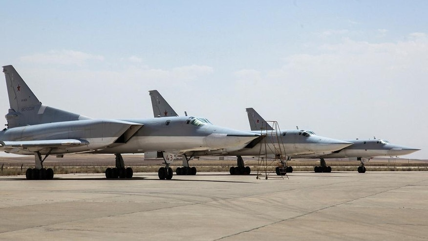 In this photo taken on Monday, Aug. 15, 2016, A Russian Tu-22M3 bomber stands on the tarmac at an air base near Hamedan, Iran. Russian warplanes took off on Tuesday Aug. 16, from Iran to target Islamic State fighters and other militants in Syria, widening Moscow's bombing campaign in Syria. (WarfareWW Photo via AP)