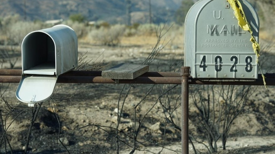 Mailboxes remain near where houses once stood Thursday, Aug 18, 2016, in Phelan, Calif. Scenes of destruction were everywhere Thursday after a huge wildfire sped through mountains and high desert 60 miles east of Los Angeles so swiftly that it took seasoned firefighters off guard. (AP Photo/Christine Armario)