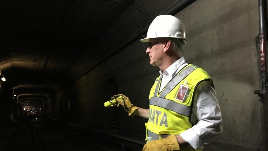 In this photo taken July 25, 2016, Metro general manager Paul Wiedefeld inspects maintenance work being done in a tunnel on Metro's orange line in northern Virginia. Wiedefeld ordered a 9-month maintenance blitz that requires sections of track to be closed for weeks at a time. He said Metro can't catch up on critical maintenance by doing work only on nights and weekends. (AP Photo/Ben Nuckols)