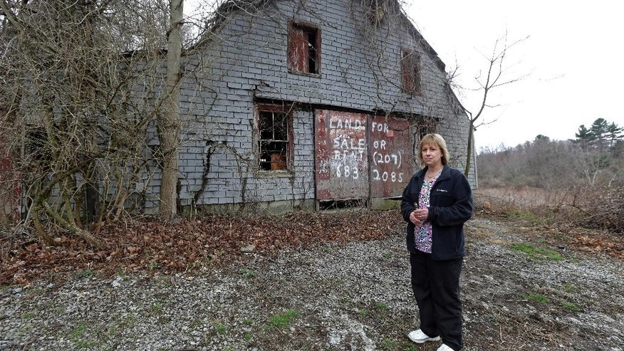 File -- In this April 12, 2016 file photo Desiree Moninski, stands on land located across from her house in Dudley, Mass., which is the site of a proposed Muslim cemetery. Federal prosecutors have opened an investigation into whether civil rights laws were violated by the town of Dudley that has rejected plans for the Muslim cemetery. (AP Photo/Elise Amendola, File)