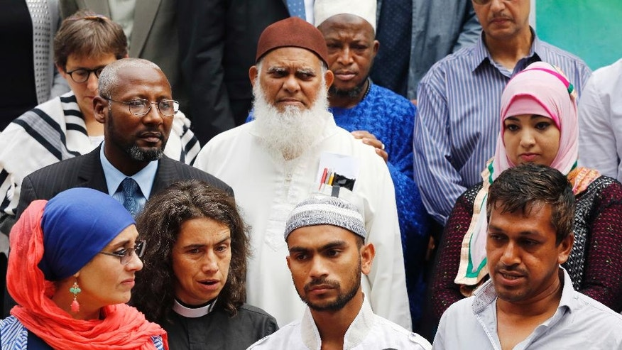 Saif Akonjee, front row third from left, son of slain Imam Maulana Alauddin Akonjee, joins with representatives of Islamic groups and leaders of the interfaith community for a news conference, Thursday, Aug. 18, 2016, at City Hall in New York. The imam and Thara Uddin were gunned down Saturday after leaving a mosque in Queens. Oscar Morel has been charged in the murders. (AP Photo/Mark Lennihan)