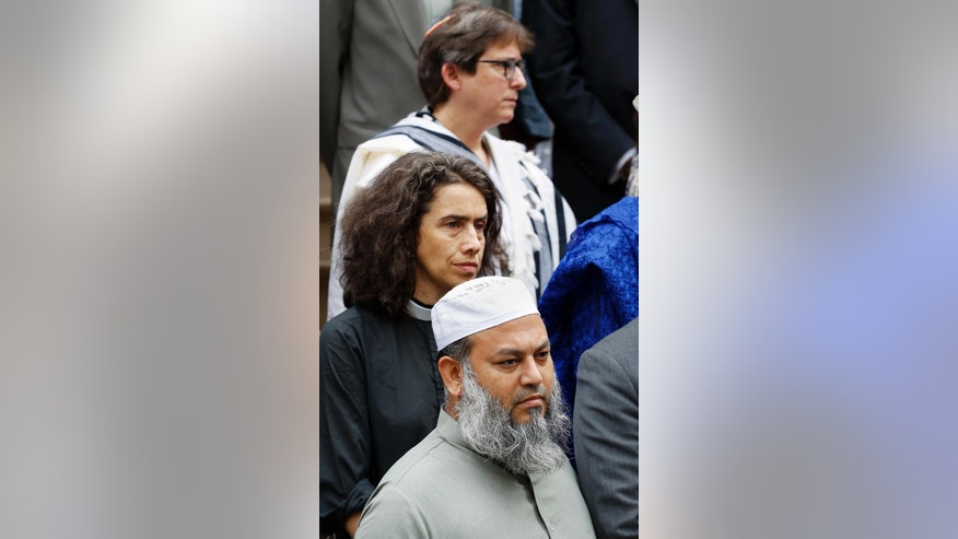 Kobir Chowdhury, bottom, Rev. Chloe Breyer, center, and Rabbi Sharon Kleinbaum join with members of the Islamic and interfaith community for a news conference regarding the murders of Imam Maulana Alauddin Akonjee and Thara Uddin, Thursday, Aug. 18, 2016, at City Hall in New York. The pair were gunned down Saturday after leaving a mosque in Queens. Oscar Morel has been charged in the murders. (AP Photo/Mark Lennihan)