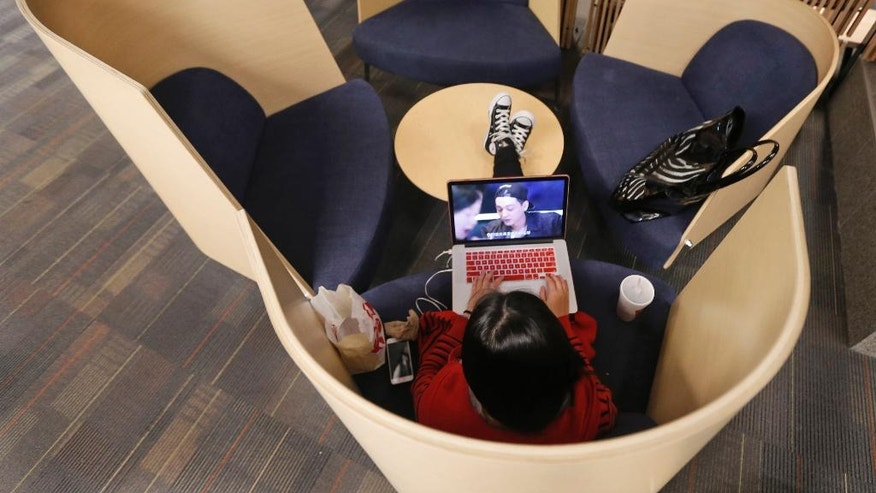 A student works on her computer in a study pod at the renovated James Branch Cabell Library on the campus of Virginia Commonwealth University in Richmond, Va., on April 18, 2016. The renovation nearly doubled the number of seats to around 3,000 and added more windows to let in natural light. (AP Photo/Steve Helber)