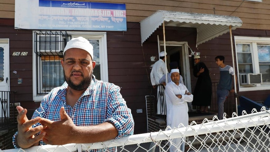 In this Wednesday, Aug. 17, 2016, photo Nurul Hoque gestures as he speaks during an interview with The Associated Press outside the Al-Furqan Jame mosque in the Ozone Park neighborhood of the Queens borough of New York.  The shooting of an imam and his assistant near their New York mosque has unnerved Muslim residents of the Ozone Park section of Queens.  (AP Photo/Mary Altaffer)