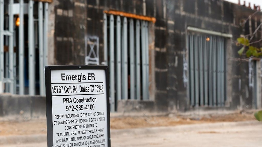 A Emergis emergency room facility sits behind a fence as construction continues, Thursday, Aug. 18, 2016, in Dallas. In just a few short years freestanding emergency centers have sprouted like mushrooms across the suburban landscape, taking root in affluent neighborhoods and directly challenging medical clinics and hospitals that may only be blocks away. (AP Photo/Tony Gutierrez)