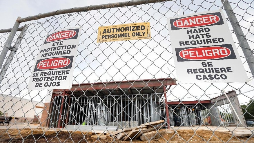 An Emergis emergency room facility sits behind a fence as construction continues, Thursday, Aug. 18, 2016, in Dallas. In just a few short years freestanding emergency centers have sprouted like mushrooms across the suburban landscape, taking root in affluent neighborhoods and directly challenging medical clinics and hospitals that may only be blocks away. (AP Photo/Tony Gutierrez)