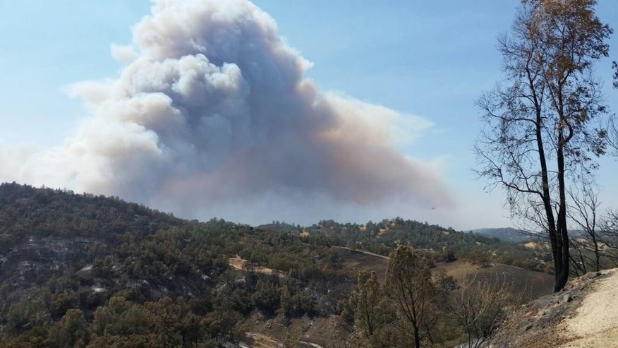 This photo provided by California Department of Forestry and Fire Protection shows smoke billowing from a wildfire in San Luis Obispo County, Calif., Saturday, Aug. 20, 2016. (California Department of Forestry and Fire Protection via AP)