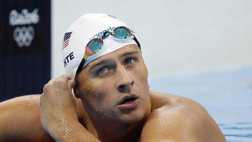 FILE - In this Tuesday, Aug. 9, 2016, file photo, United States' Ryan Lochte checks his time in a men's 4x200-meter freestyle heat during the swimming competitions at the 2016 Summer Olympics, in Rio de Janeiro, Brazil. Speedo announced Monday, Aug. 22, 2016, that they are dropping their sponsorship of Lochte. The swimsuit maker says that it doesn't condone behavior that is counter to its values. Lochte fabricated a tale that he was robbed at gunpoint in Rio de Janeiro during the Olympics. He later apologized. (AP Photo/Michael Sohn, File)