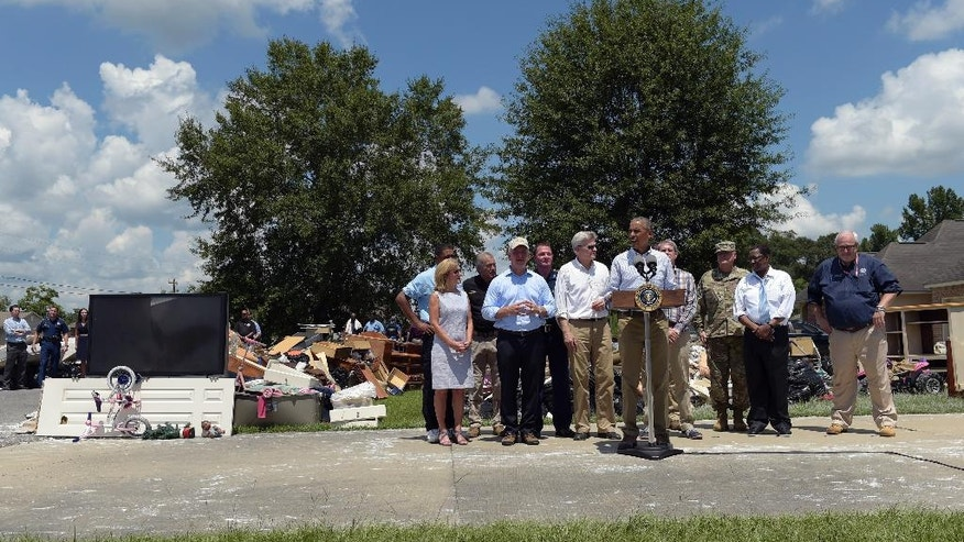 President Barack Obama makes a statement on the flooding following a tour of Castle Place, a flood-damaged area of Baton Rouge, La., Tuesday, Aug. 23, 2016. Obama is making his first visit to flood-ravaged southern Louisiana as he attempts to assure the many thousands who have suffered damage to their homes, schools and businesses that his administration has made their recovery a priority. (AP Photo/Susan Walsh)