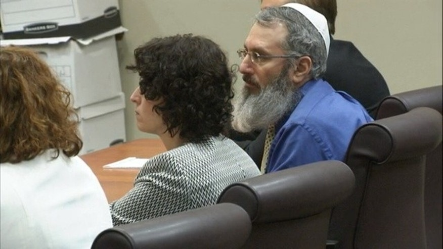 Hemy Neuman, right, in court.